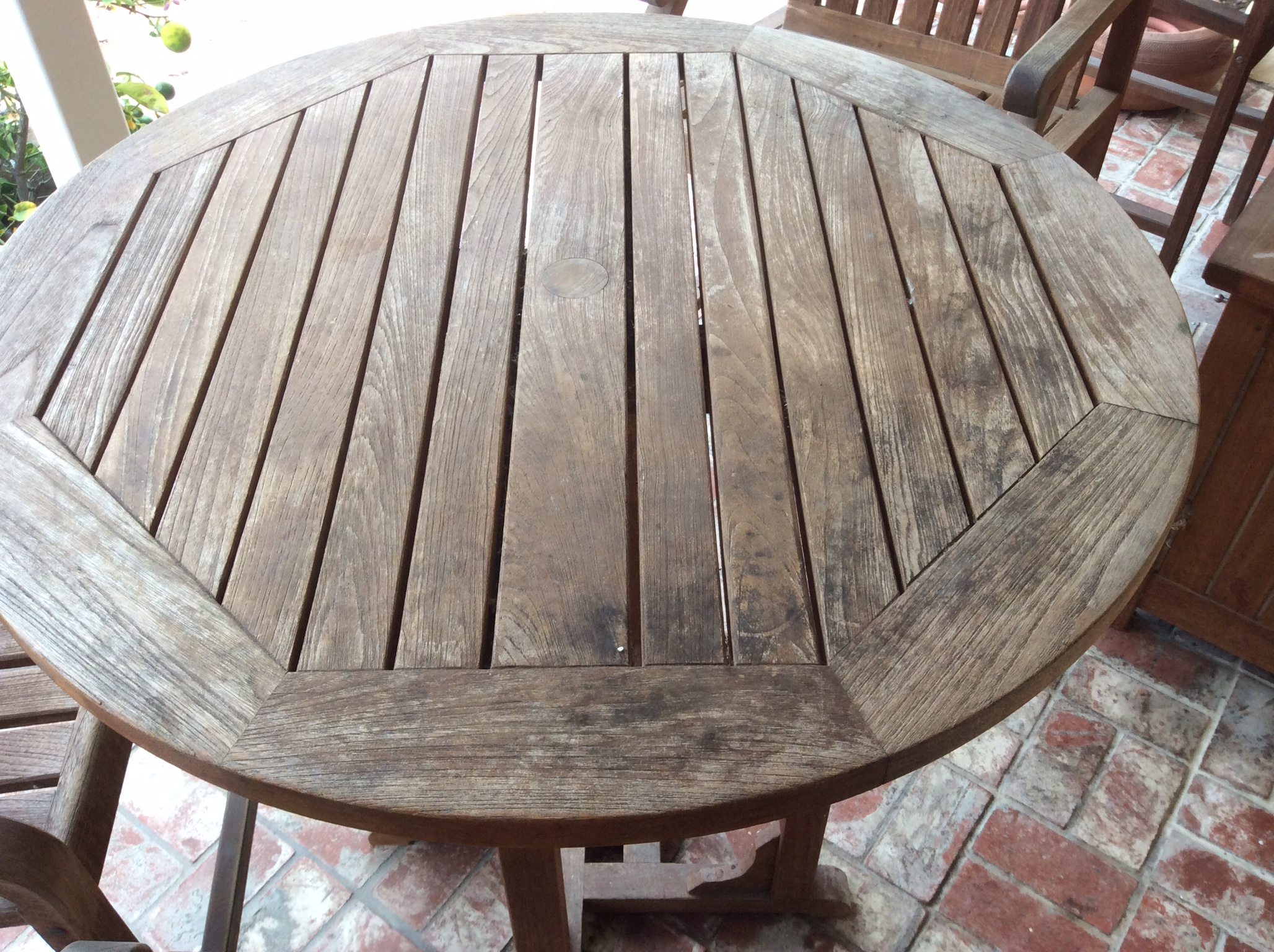 We got to work refinishing the weathered wood  using the right products and  techniques to let that natural beauty shine through again. Refinishing Teak Outdoor Furniture   Wilson Painting