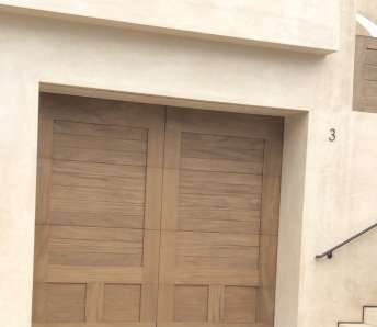 Take a Look at This Custom-Stained, Mahogany Garage Door